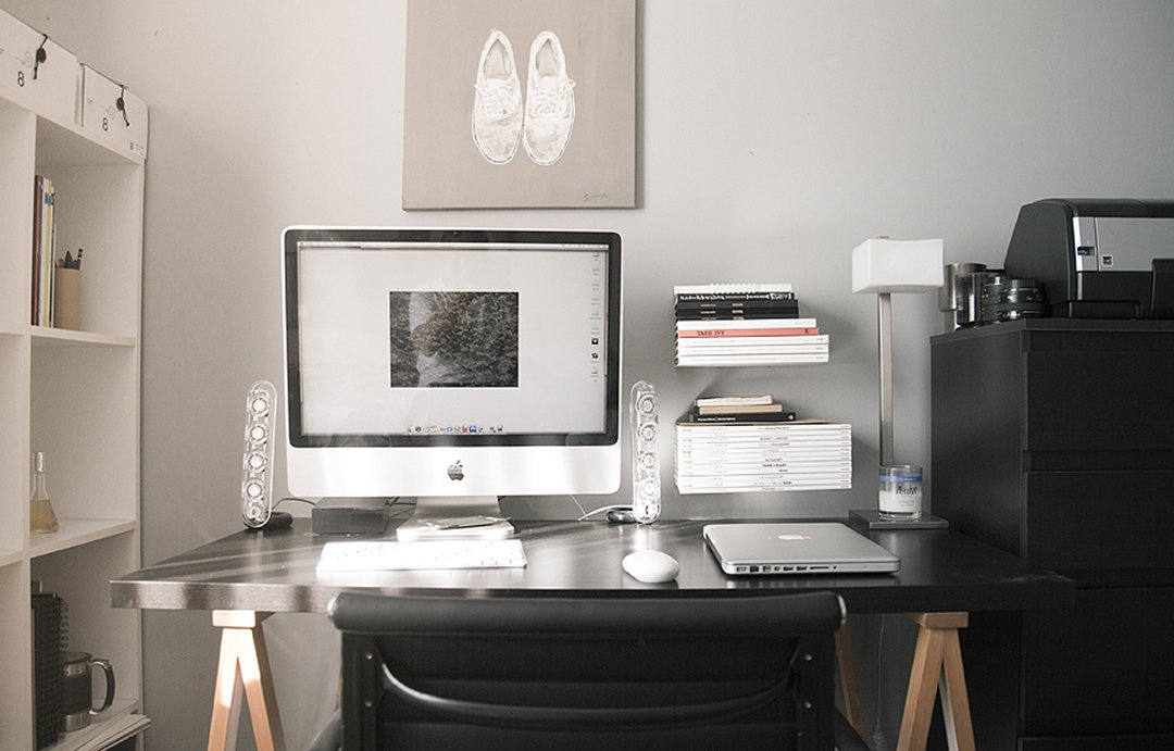pA web designers desk with printer and mouse
